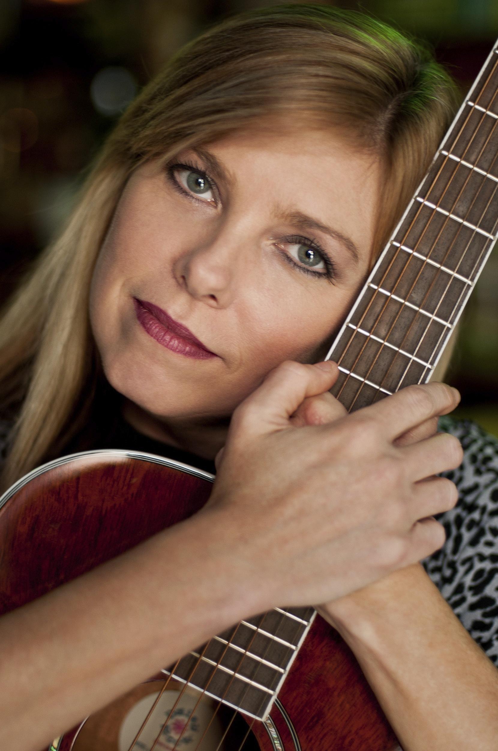 Lani closeup with guitar big_re